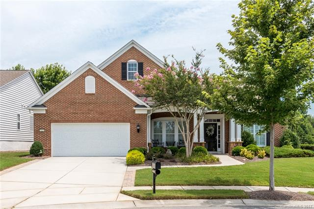 Unbelievable Brick Front Home w/ 3-Season Room on private Golf view lot!